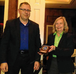 John Braun being presented with a plaque for the Boy Scouts of America District Award of Merit.