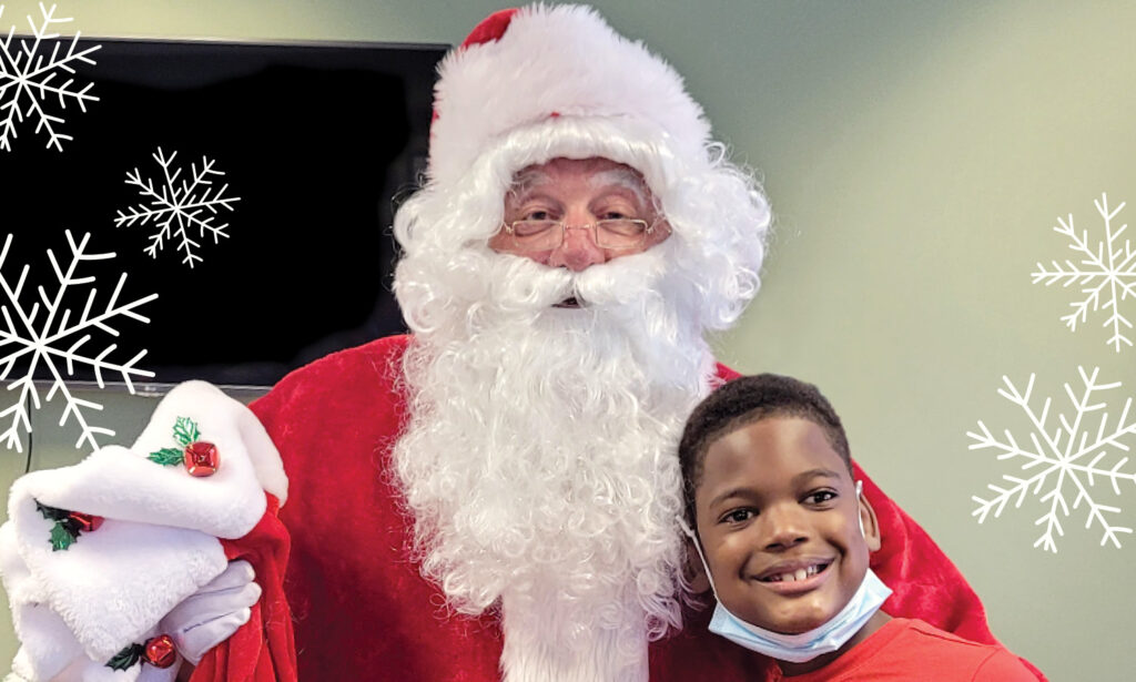 Santa Claus posing with an SSSRA participant.